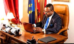Godon at his desk